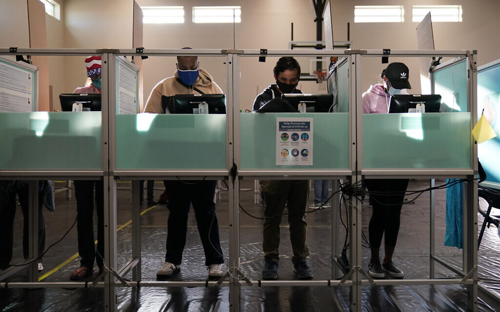 People vote at a polling place on Election Day, Tuesday, Nov. 3, 2020, in Las Vegas. (AP/John Locher)