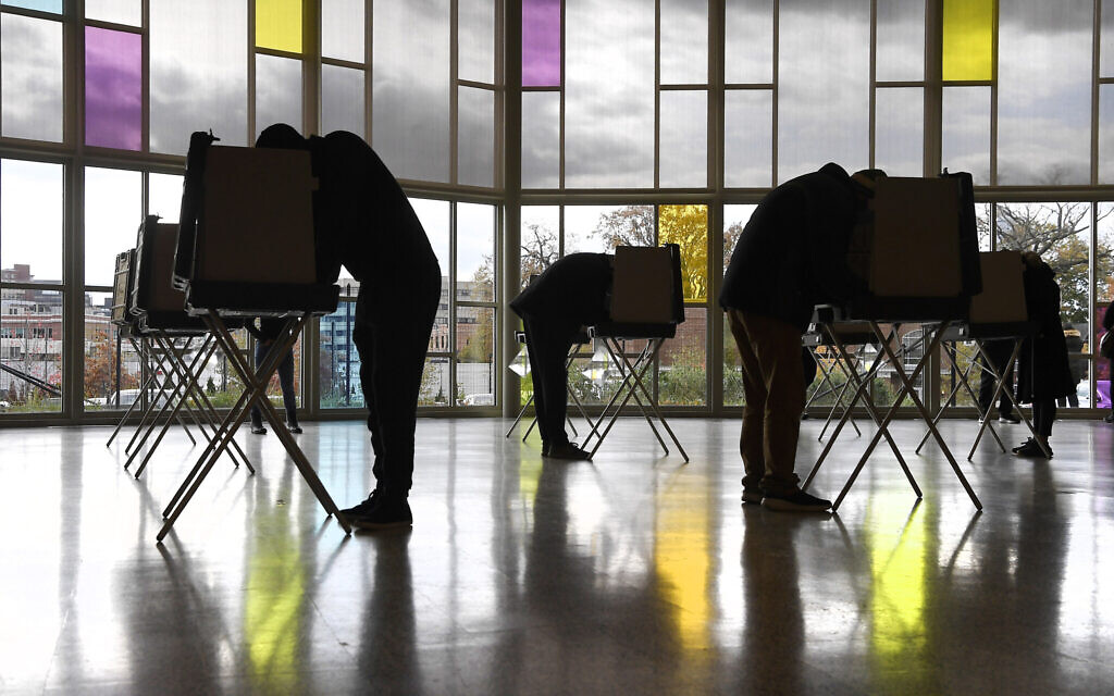 Voters mark their ballots at First Presbyterian Church on Election Day, Tuesday, Nov. 3, 2020, in Stamford, Conn. (AP/Jessica Hill)