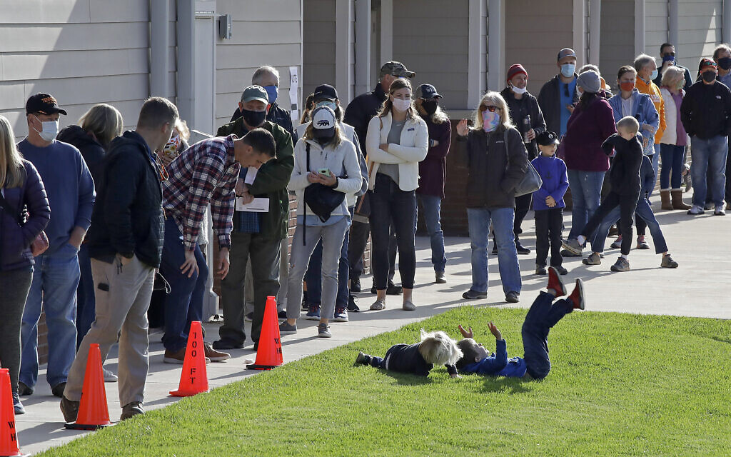 Children play as voters wait in line to cast their ballots at Waldens Ridge Emergency Services building on Election Day, Nov. 3, 2020, in Walden, Tennessee. (AP/Ben Margot)