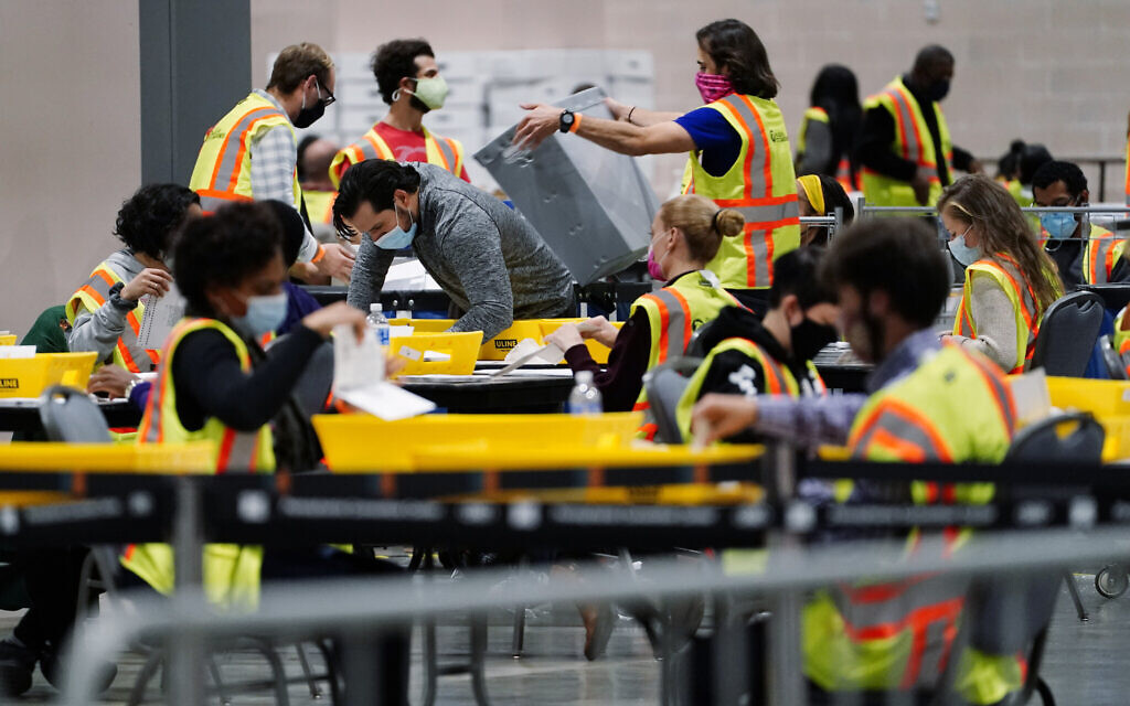 Philadelphia election workers process mail-in and absentee ballots for the general election, at the Pennsylvania Convention Center, Nov. 3, 2020, in Philadelphia. (AP Photo/Matt Slocum)