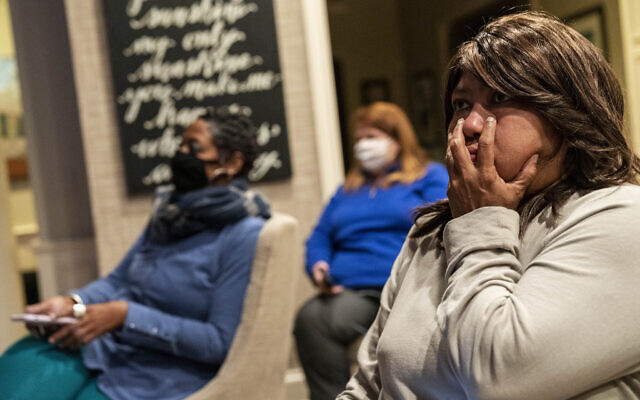 Rita Brown, a supporter of Democratic presidential candidate former Vice President Joe Biden, watches election results at a watch party in Bloomfield Hills, Michigan, Nov. 3, 2020. (AP Photo/David Goldman)