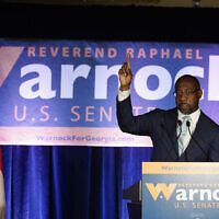 Raphael Warnock, a Democratic candidate for the US Senate, speaks during a rally on November 3, 2020, in Atlanta. (AP Photo/Brynn Anderson, Pool)