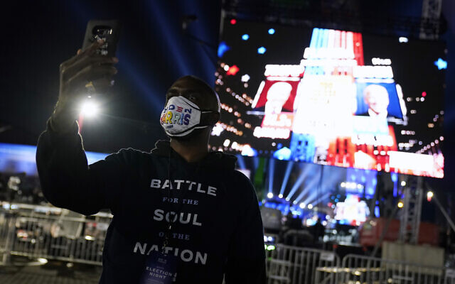 People arrive for an election night rally for Democratic presidential candidate former Vice President Joe Biden on Tuesday, Nov. 3, 2020, in Wilmington, Del. (AP Photo/Andrew Harnik)