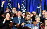 Supporters pose with US Sen. Lindsey Graham, center, following his victory speech after winning another term in office on Tuesday, Nov. 3, 2020, in Columbia, South Carolina (AP Photo/Meg Kinnard)