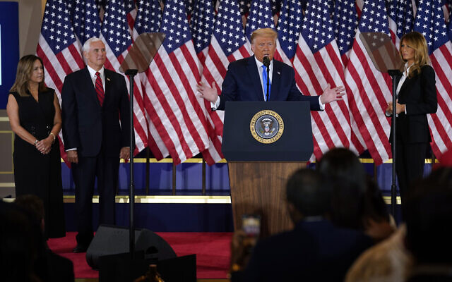US President Donald Trump speaks in the East Room of the White House, early November 4, 2020, in Washington, as Vice President Mike Pence and Karen Pence and First Lady Melania Trump listen. (AP Photo/ Evan Vucci)