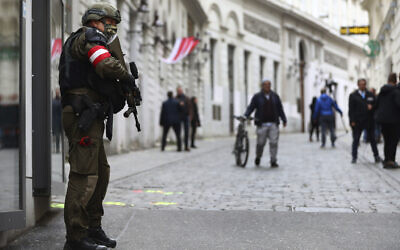 A military police officer guards at the crime scene near a synagogue in Vienna, Austria, November 4, 2020. Several shots were fired shortly after 8 p.m. local time on November 2, in a lively street in the city center of Vienna. (AP Photo/Matthias Schrader)