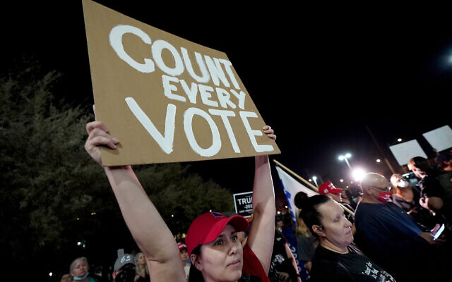 US President Donald Trump supporters rally, Wednesday, Nov. 4, 2020, outside the Maricopa County Recorders Office in Phoenix. (AP Photo/Matt York)
