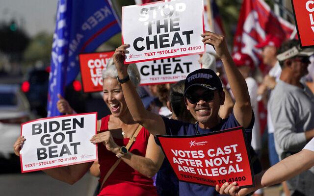 People rally for US President Donald Trump outside City Hall, November 5, 2020, in Phoenix, Arizona. (AP /Matt York)