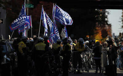 Supporters of US President Donald Trump demonstrate outside the Pennsylvania Convention Center, Nov. 5, 2020, in Philadelphia, as vote counting in the general election continues. (AP Photo/Rebecca Blackwell)