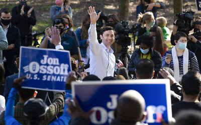 Georgia Democratic candidate for US Senate John Ossoff rallies supporters for a run-off against Republican candidate Senator David Perdue, as they meet in Grant Park, November 6, 2020, in Atlanta. (AP Photo/John Amis)