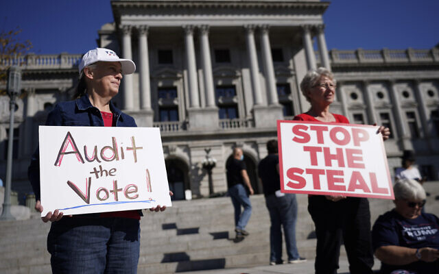 People demonstrate outside the Pennsylvania State Capitol, Friday, November 6, 2020, in Harrisburg, Pennsylvania, as vote counting continued. (AP Photo/Julio Cortez)
