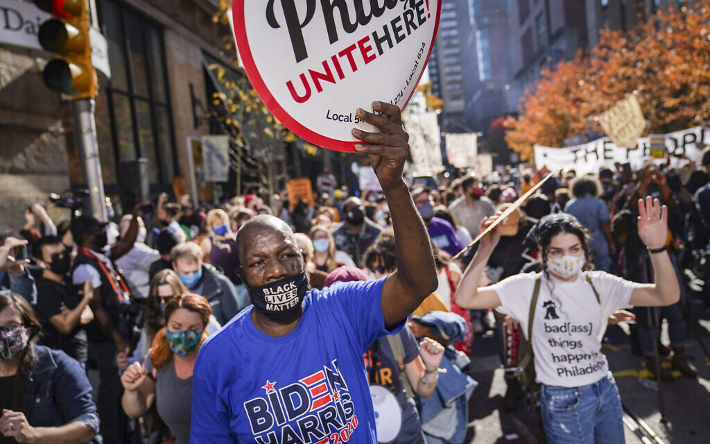 Demonstrators supporting the continuing vote count gather outside the Philadelphia Convention Center three days after the presidential election polls closed as they await tabulation results, Nov. 6, 2020, in Philadelphia. (AP Photo/John Minchillo)