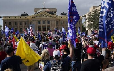 Supporters of US President Donald Trump rally outside the Arizona state capitol on November 7, 2020, in Phoenix. (AP Photo/Ross D. Franklin)