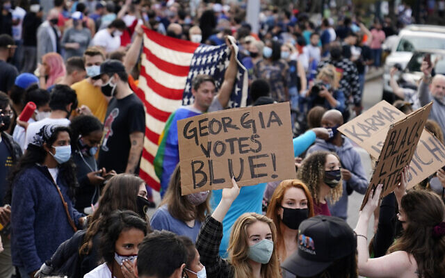People celebrate Joe Biden's victory in the Presidential election Saturday, Nov. 7, 2020, in Atlanta. (AP Photo/Brynn Anderson)
