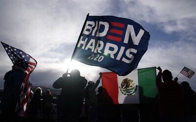 Supporters of US President-elect Joe Biden and Vice President-elect Kamala Harris wave flags in Las Vegas, Nov. 7, 2020 (AP Photo/Jae C. Hong)