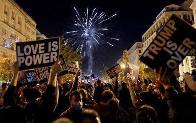 People shoot off fireworks in Black Lives Matter Plaza while celebrating president-elect Joe Biden's win over President Donald Trump to become the 46th president of the United States, Saturday, Nov. 7, 2020, in Washington. (AP/Jacquelyn Martin)