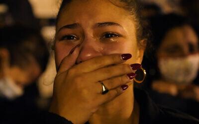 Angelique McKenna reacts to President-elect Joe Biden's victory speech while listening at Black Lives Matter Plaza, Saturday, Nov. 7, 2020, in Washington. (AP Photo/Jacquelyn Martin)