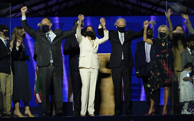 From left, Doug Emhoff, husband of Vice President-elect Kamala Harris, Harris, President-elect Joe Biden and his wife Jill Biden on stage together, Saturday, Nov. 7, 2020, in Wilmington, Del. (AP/Andrew Harnik)