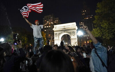 Revelers celebrate in Washington Square Park after former vice president and Democratic presidential candidate Joe Biden was announced as the winner over President Donald Trump to become the 46th president of the United States,, Saturday, Nov. 7, 2020, in New York. (AP Photo/Mary Altaffer)