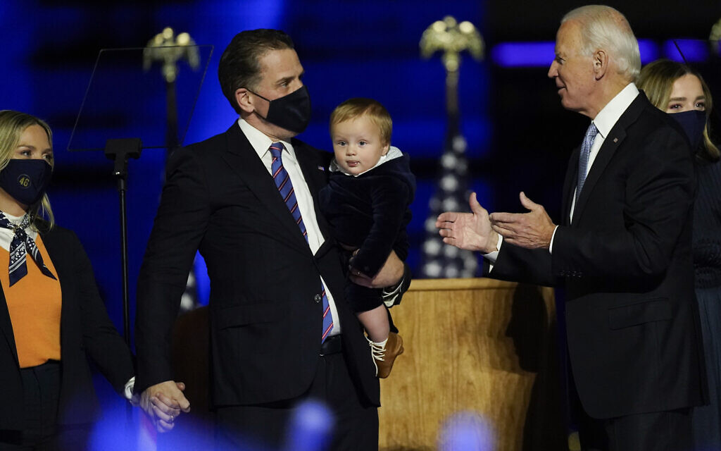 President-elect Joe Biden greets his son Hunter Biden and wife Melissa Cohen, left, as he holds his son, as he stands on stage with his family November 7, 2020, in Wilmington, Delaware. (AP Photo/Andrew Harnik)