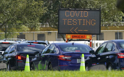 Cars line up at a COVID-19 testing site at Tropical Park, Saturday, Nov. 14, 2020, in Miami. (AP Photo/Wilfredo Lee)