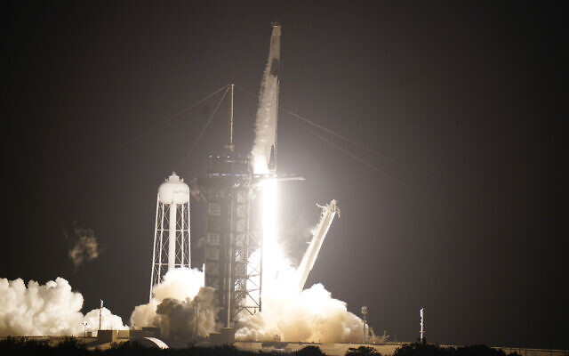 A SpaceX Falcon9 rocket, with the Crew Dragon capsule attached, lifts off from the Kennedy Space Center's Launch Complex 39-A, November 15, 2020, in Cape Canaveral, Florida. (AP Photo/John Raoux)