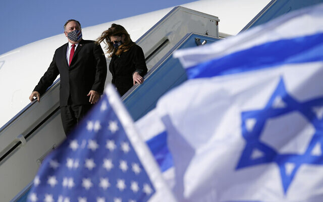 US Secretary of State Mike Pompeo and his wife Susan step off a plane at Ben Gurion Airport in Tel Aviv, Nov. 18, 2020 (AP Photo/Patrick Semansky, Pool)