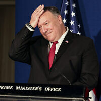 US Secretary of State Mike Pompeo pats his head during a joint press conference with Benjamin Netanyahu and Bahrain's Foreign Minister Abdullatif bin Rashid Alzayani after their trilateral meeting in Jerusalem on Wednesday, Nov. 18, 2020. (Menahem Kahana/Pool via AP)