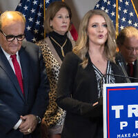 Members of US President Donald Trump's legal team, including former Mayor of New York Rudy Giuliani, left, Sidney Powell, and Jenna Ellis, speaking, attend a news conference at the Republican National Committee headquarters on November 19, 2020, in Washington. (AP/Jacquelyn Martin)