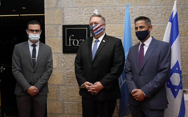 US Secretary of State Mike Pompeo, center, poses for a photo with Daniel Voiczek, left, general manager and CEO of the Friends of Zion Museum, and Nir Kimhi, the museum founder's representative in Israel, as he arrives for a tour of the Friends of Zion Museum, November 20, 2020, in Jerusalem. (AP Photo/Patrick Semansky, Pool)
