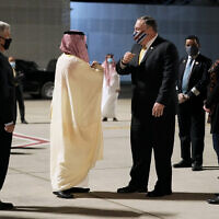 US Ambassador to Saudi Arabia John Abizaid, left, and Saudi Arabia's Foreign Minister Faisal bin Farhan, second from left, greet Secretary of State Mike Pompeo and his wife Susan as they arrive at Neom Bay Airport in Neom, Saudi Arabia, Sunday, Nov. 22, 2020. (AP Photo/Patrick Semansky, Pool)