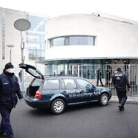 A car stands in front of the chancellery after it crashed into the front gate of the building housing German Chancellors Angela Merkel's offices in Berlin, Germany, November 25, 2020. (Michael Kappeler/dpa via AP)