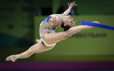 Linoy Ashram of Israel performs with the ribbon during the 36th European Rhythmic Gymnastics Championships in Kyiv, Ukraine, Sunday, Nov. 29, 2020. (AP Photo/Efrem Lukatsky)