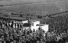 Over 100,000 members of Hitler's stormtroopers at the huge Nazi rally in the Leopold Arena in Nuremberg, on Sept. 15, 1935, listen as German Chancellor Adolf Hitler speaks to them. (AP Photo)