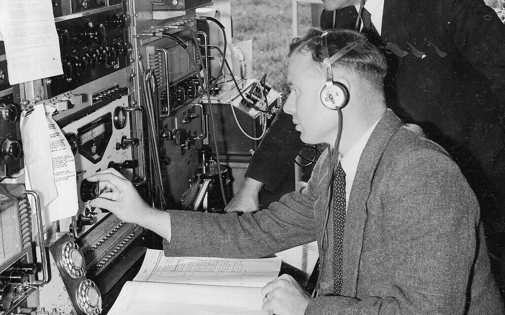 Engineers listen to radio signals broadcast by the Soviet satellite Sputnik as it circles the Earth, at the British Broadcasting Corporation's measurement and receiving station at Tatsfield, Kent, October 7, 1957. (AP Photo)
