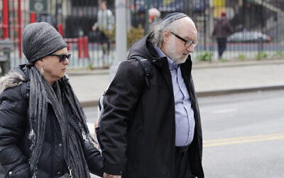Convicted spy Jonathan Pollard and his wife, Esther, enter federal court in New York on April 7, 2016. (AP Photo/Mark Lennihan)