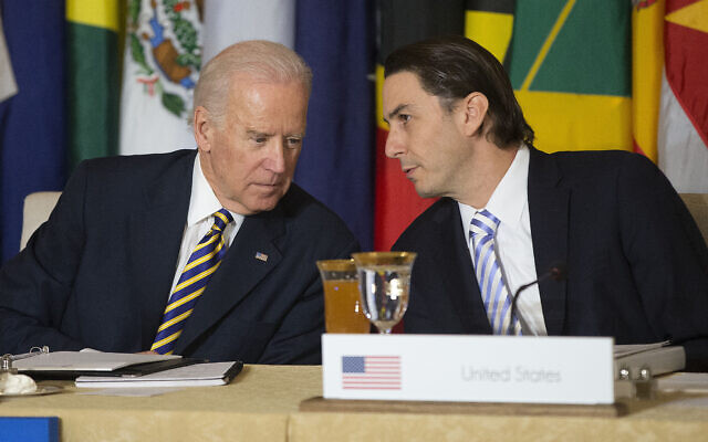 Then US vice president Joe Biden, left, talks with then State Department special envoy for international energy affairs Amos Hochstein at a working lunch during the Caribbean Energy Security Summit, at the State Department in Washington, January 26, 2015. (AP Photo/Pablo Martinez Monsivais/File)