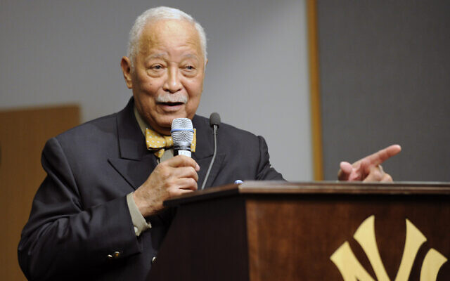Former New York City mayor David Dinkins speaks to the media before the unveiling of a plaque honoring Nelson Mandela in Monument Park, April 16, 2014, at Yankee Stadium in New York. (AP Photo/Bill Kostroun)