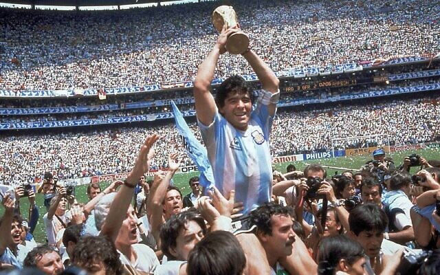 FILE - This is a June 29, 1986  file photo  of  Diego Maradona of Argentina celebrates with the cup at the end of the World Cup soccer final in the Atzeca Stadium, in Mexico City, Mexico on June 29, 1986. (AP/Carlo Fumagalli)
