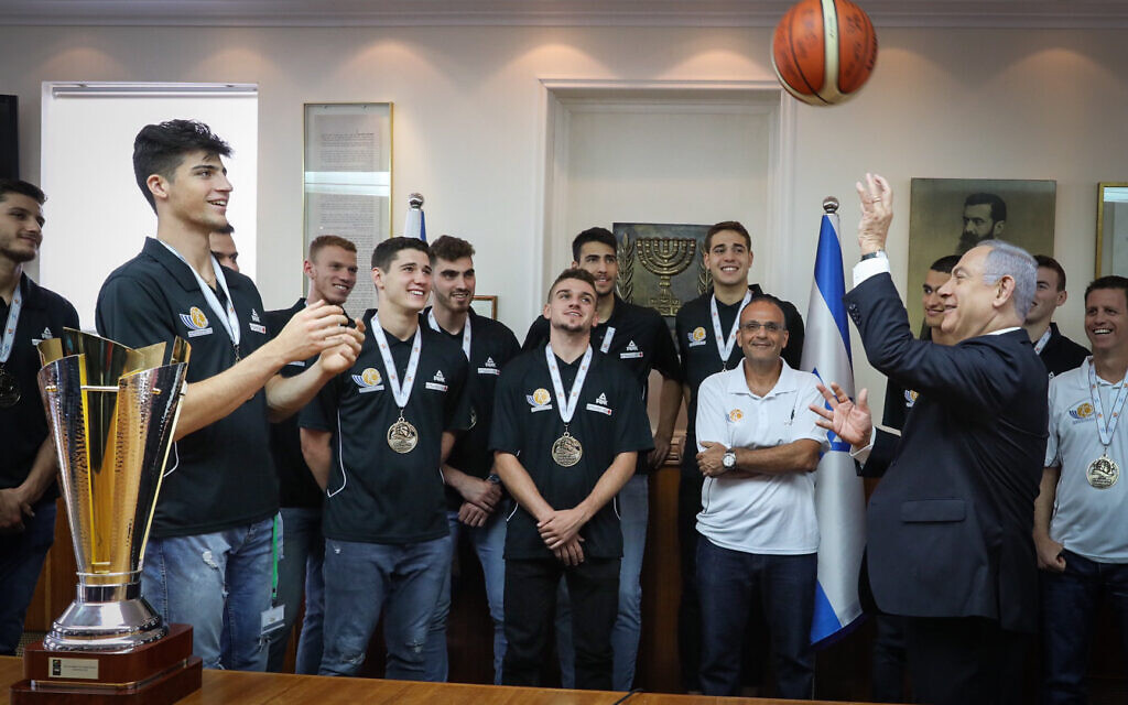 Prime Minister Benjamin Netanyahu and Deni Avdija after the Israel youth basketball team's victory at the FIBA European Championships, at the Prime Minister's Office on July 24, 2019 (Marc Israel Sellem/POOL)