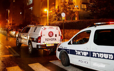 Illustrative: Police and medical personnel at the scene where police were investigating a suspected murder-suicide in Petah Tikva, January 17, 2020. (Roy Alima/Flash90)
