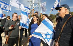 Likud supporters hold flags near then-minister of Diaspora Affairs Tzipi Hotovely at a demonstration demanding Israeli sovereignty over the West Bank, February 27, 2020 (Gershon Elinson/Flash90)
