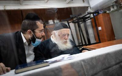 Rabbi Chaim Kanievsky and his grandson Yaakov (Yanki) Kanievsky (L) at the former's home in the ultra-Orthodox city of Bnei Brak on September 22, 2020. (Aharon Krohn/Flash90)