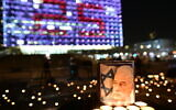Israelis light candles, as part of a display of 25,000 memorial candles in honor of the 25th Memorial Day for the assassination of late prime minister Yitzhak Rabin, at Rabin Square in Tel Aviv on October 29, 2020.(Tomer Neuberg/Flash90)