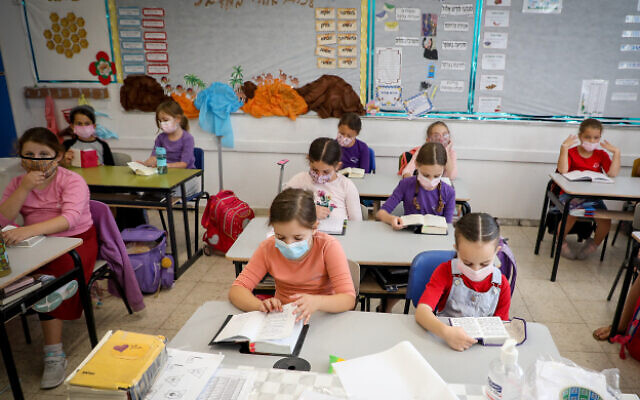Illustrative: Students wear masks in a classroom in the Jewish settlement of Efrat, in the West Bank, on November 1, 2020 (Gershon Elinson/Flash90)