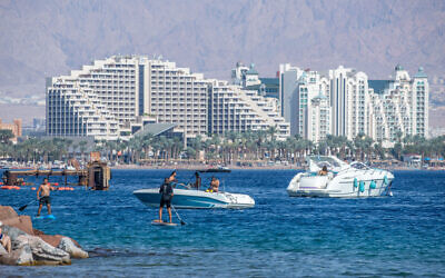 People enjoy the beach in the resort city of Eilat, on November 6, 2020. (Yossi Aloni/Flash90)