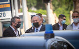 Prime Minister Benjamin Netanyahu seen surrounded by security as he enters his car, after an unofficial, surprise visit in Givatayim, near Tel Aviv on November 9, 2020. (Miriam Alster/Flash90)