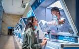 A technician collects nasal swab samples for COVID-19 at the new coronavirus lab, at Ben-Gurion International Airport, near Tel Aviv on November 9, 2020. (Yossi Aloni/Flash90)