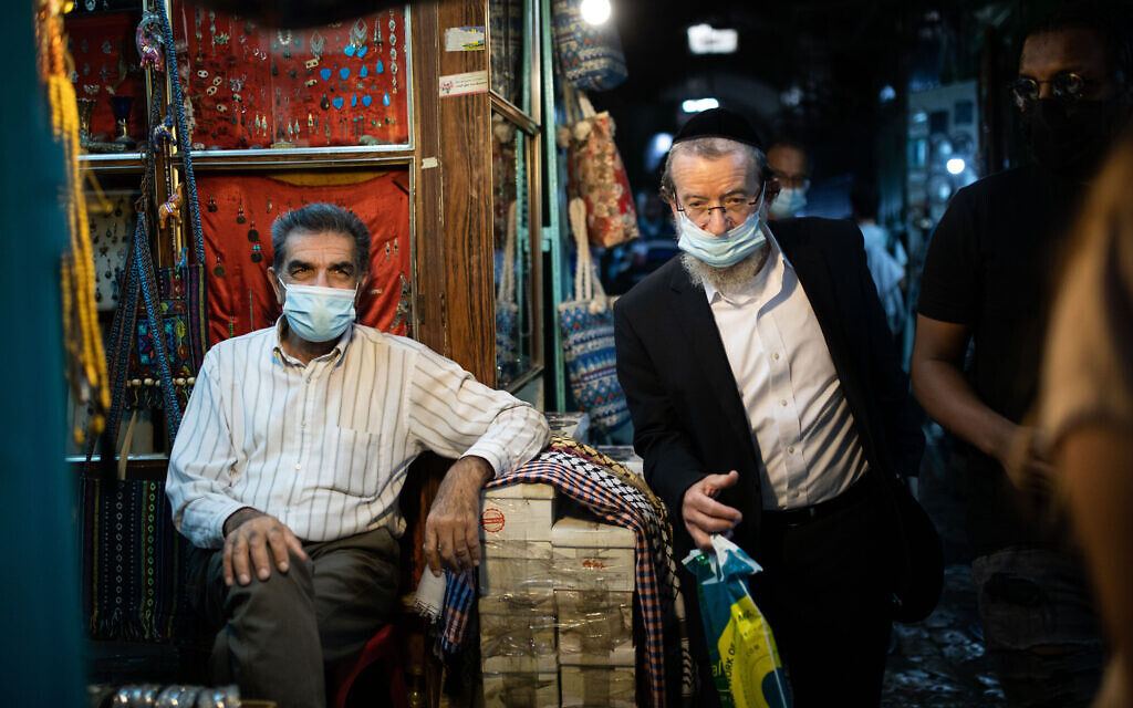 People wearing face masks in the Old City of Jerusalem on November 13, 2020, after coronavirus restrictions preventing the opening of shops were eased. (Hadas Parush/Flash90)