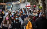 Israelis wearing face masks walk on Jaffa Street in downtown Jerusalem, on November 19, 2020. (Olivier Fitoussi/Flash90)
